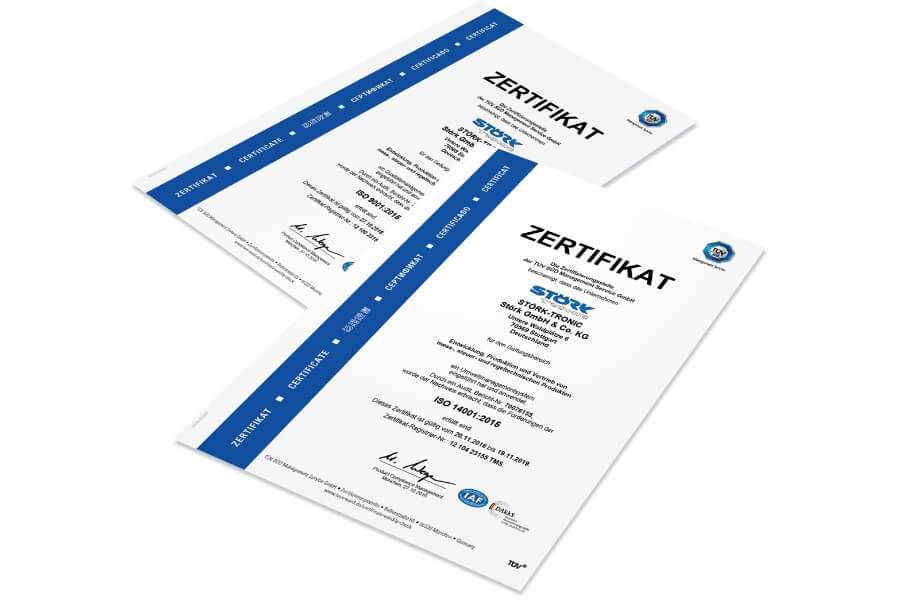[Translate to Englisch:] Störk-Tronic Zertifizierung, ISO, 9001:2015, TÜV Süd Management Service GmbH, Qualitätsmanagementsystem. Störk-Tronic Zertifizierung, ISO, 14001:2015, TÜV Süd Management Service GmbH, Umweltmanagementsystem.